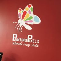 Painting Pixels Wall Logo Close Up